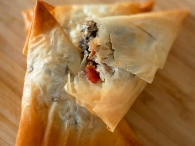 Creamy Mushroom Phyllo Triangles with Bacon Filling